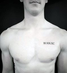 Roman Numerals Upper Chest Tattoo For Guys With Small Design