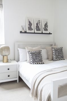 Beautiful bedroom decor inspiration - neutral scandi inspired room by Topology designer Athina. The colour scheme of this girls bedroom is calm with rich taupes and pops of black. There are a moroccan boho elements combined with contemporary design. Light coloured bed frame and a floating shelf / picture rail to contrast. Light is from House Doctor.