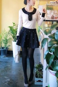 Skirt crafted in polyester, featuring a slim high waistband with ruched trims, all over pearl detail to front, A-line style with soft pleats.$25