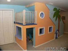 Kiddie clubhouse built under the steps. I'd love to do this when we finish the basement!