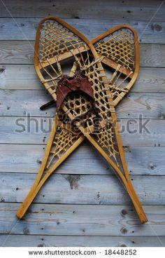 Old Snowshoes Hanging On Wall