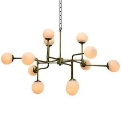 The Taranto Chandelier by Noir emphasizes natural, simple and classic design. Noir has been designing, building and importing a very unique, but ever growing collection of home furnishings for more than 10 years.  <i>Noir products are hand finished and created with a concentrated effort toward environmental sustainability. Variations could occur and are not considered as product defects.</i>  Materials: Metal  Finish: Antique Brass  Includes 6 feet of chain and cord. Includes large ca...