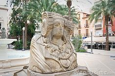 A monument of Elche & x28;Alicante& x29; symbol in a middle of small park