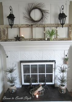 Old door lights - window in front of the fireplace - door on the mantle - vintage hooks down the sides