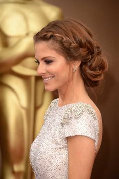 Maria Menounos' braided up-do was right on trend at this years Oscar awards. To get this look, apply mousse to clean hair to give some texture, and curl hair to give loose waves. Make two messy plaits, either side of the parting, taking more hair as you work towards the nape of the neck. Pin the ends in place to create a bun. Pull some hair out of the plait for a less 'done' look. Finish with hairspray.
