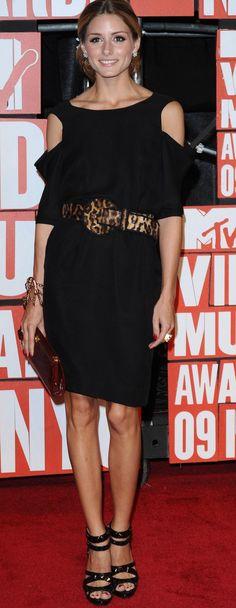Olivia Palermo wearing a leopard belt with black dress