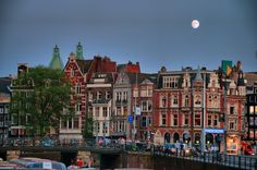 Read about easy ways to save while visiting Amsterdam, including tips for saving on hotels, food, drinks and sightseeing. More Amsterdam advice: Amsterdam Houses, Visit Amsterdam, Amsterdam Travel, Amsterdam Holland, Beautiful Places In The World, Great Places, Places To See, Amazing Places, Wonderful Places