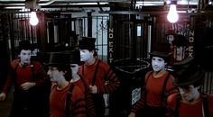 The Hi-Hats - The Warriors Gang/This gang from Soho, Manhattan look like a cross between mime artists and clowns. Wearing red and black outfits with black tophats and white painted faces, they can be seen in the subway and at the meeting in The Bronx.