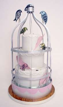 Let the Caged Bird Sing:  Though this cake by Charm City Cakes is small by over-the-top wedding standards, it is set inside an ornamental bird cage with decorative birds and feathers.