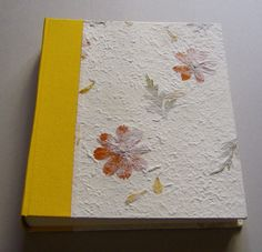 Photo Album - Handmade work    Dimension: 20,5 x 24 cm, 30 pages (60 front and back) of heavy ivory card stock with interleaved glassine sheets.   It's possible customize the album by choosing the color of the canvas, the kind of paper and the size.