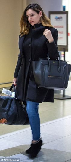 Moving on: Kelly put her best foot forward as she strolled through the airport - with no sign of David