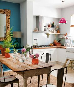 Kitchen, light and bright with fun colors and turquoise blue wall in dining area