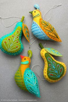 Hey, a photo, look at that. These are some wool felt ornaments I've been making. The design is a reprise of the Partridge & Pear ornaments I made for gifts a while back. I'm pretty happy with this new pattern (unfortunately I lost the original pattern. Felt Christmas Decorations, Felt Christmas Ornaments, Handmade Christmas, Christmas Tree, Tree Decorations, Embroidered Christmas Ornaments, Christmas Placemats, Bird Ornaments, Beaded Ornaments