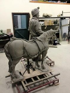 Peter Walker's coal miner and pit pony in clay - then to bronze (first seen on horseandman).
