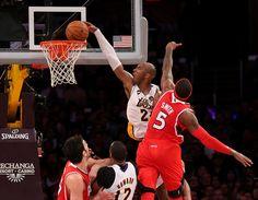 Kobe Bryant dunks over Josh Smith.