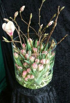 Spring style!! Modern contemporary floral arrangement in a large glass cylinder-shaped vase! Pink flowering branches and pink tulips!