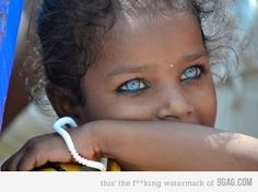 amazing eyes - taken for National Geographic in Varnasi, India.  With much appreciation to Lily Pink for the additional information