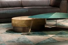 Love the idea of layered coffee tables. Metal + marble?