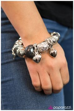 $5.00 Quantity: add to bag Product Description  Rich black beads, silver accents, and charms are threaded along a stretchy band in this fun design. Charms include hearts, silver beads, and a four-leaf clover.  Sold as one individual bracelet.
