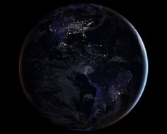 NASA scientists are releasing new global maps of Earth at night, providing the clearest yet composite view of the patterns of human settlement across our planet. This composite image, one of three new full-hemisphere views, provides a view of the Americas at night.