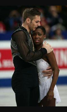Vanessa James is comforted by partner Morgan Cipres of France after she was dropped on the ice in the Pairs Free Program during ISU World Figure Skating Championships at Saitama Super Arena on March 2014 in Saitama, Japan. Vanessa James Morgan Cipres, Afro, Saitama Super Arena, Michigan, Venus And Serena Williams, Black Woman White Man, Foxy Brown, World Figure Skating Championships, Lil Yachty