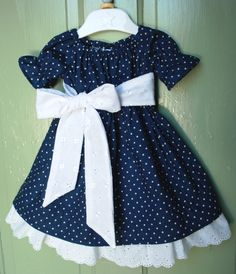 Girls dress in navy Blue dots with gorgeous eyelet trim and sash. $40.00, via Etsy.
