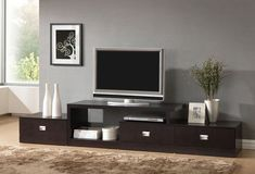 """Baxton Studio Marconi Brown Modern TV Stand A versatile Marconi TV Stand is a marvel of superior function and style.Three drawers paired with ample open shelving and top surface space for storing or displaying items.This modern entertainment stand is made of mixed engineered woods with Dark brown faux wood grain paper veneer and silver drawer pulls. Malaysian-made.TV stand requires assembly and dusted clean with a dry clothFeatures:Transitional TV stand (fit 47"""" TV and 55"""" flat panel TV…"""