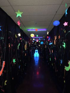 Hallway tip! Design one hallway with black lights! Paint paper stars, lanterns, and space shapes with glow-in-the-dark colors. (Note: You may wish to supervise this hallway in case any of your Voyagers are sensitive to the lights.An exciting new adventure Alien Party, Outer Space Party, Outer Space Theme, Space Theme Decorations, Paper Star Lanterns, Space Classroom, Galaxy Theme, Paper Light, Glow Party