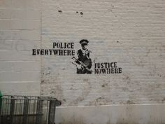 police everywhere; justice nowhere - Banksy