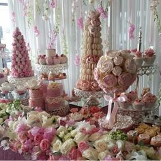 Gorgeous pink dessert table with cupcake topiary, macaroon tower, and chocolate-covered strawberries tower.
