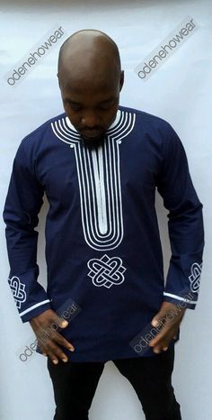 Odeneho Wear Mens Navy Blue Polished Cotton Top With Embroidery Design Long Sleeves Top Only..  Our top and bottom are usually custom made. Please email us if you have the dimensions you want us to us.  We use the size chart of USA to make our clothes.  All sizes available.  Please note: these measurements are general. If you have the choice to measure yourself with a measuring tape, please opt to send us those measurements rather to ensure an even greater quality fit.   PLEASE NOTE THAT ALL…