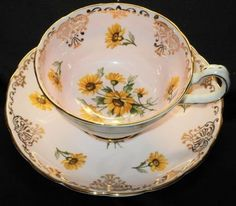 I have one of these in my collection except it is a pale pale green/yellow instead, it goes well with the flowers- Grosvenor England Royal Brown Eye Susan Pale Pink Cup and Saucer Set