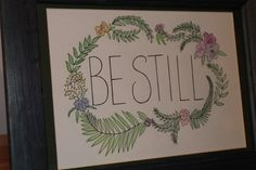BE STILL - hand drawn written art piece with floral border in wooden frame