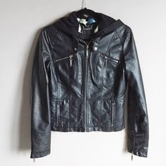 NWOT Jou Jou faux leather moto jacket Very cute and stylish faux moto leather jacket. NWOT and never worn. Has a lot of zipper detailing for an edgy look and also a detachable hood. Great quality jacket in new condition. ❌no trades. Jou Jou Jackets & Coats