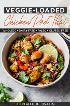 Enjoy this easy dinner recipe of healthy pad Thai!  A gluten free pad Thai recipe that's loaded with veggies and full of flavor.  This Healthy Chicken Pad Thai recipe is a healthy weeknight dinner the whole family will love.  || The Real Food Dietitians ||
