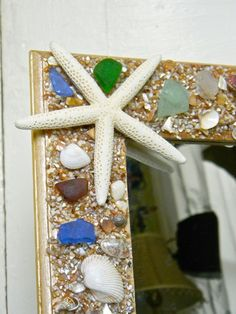 Handmade Beach Glass & Sea Shell Embellished Wooden Mirror One of a Kind. $25.00, via Etsy.