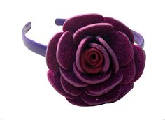 Pink color flower Hair-band (one flower), made of imported  rubber sheets, designed and crafted by village women, giving a   new fashion style to hair accessories.  Color: Pink   Material: Imported Rubber sheets   Base material: Imported plastic Hair-band