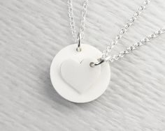 One heart cut from another, this white heart pendant necklace set represents eternal love and an unbreakable bond. Perfect if you're looking for Mothers Day gift ideas, this mother daughter necklace set makes a beautiful gift for mum, supplied in a single gift box and finished with ribbon and a gift tag.  What could bring you closer than wearing two parts of the same heart, you will always feel connected. This heart necklace set is also ideal for sisters or best friends.
