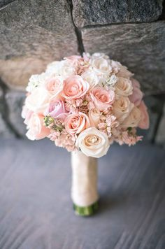 This romantic spring wedding bouquet features beautiful soft pink flowers.