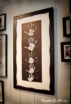 Picture Frame Family Handprints Keepsake. This would be a cute project along with the yearly school pictures.