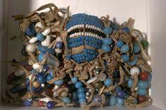Crow medicine with powder blue pony beads employed.