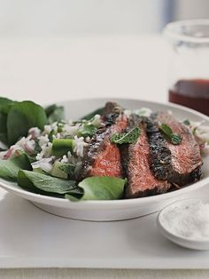rice salad    This dish combines salad greens, grilled steak, fresh veggies and rice for a tasty and balanced one-bowl supper.