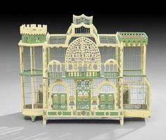 Victorian Birdcage, late 19th century, in the form of a fanciful mansion, fitted with four doors, two metal-lined feed and water troughs and a metal lining, one end turreted