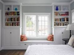 Windows With Seats fireplace, window seat with drawers under, bookshelf with doors