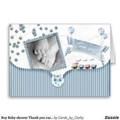 This is a baby shower thank you card for a baby shower or after baby arrives in blue and white to thank family and friends for all their well wishes and gifts.It features balloons, photo frame, buttons, a little train and some bling!. You must add your own picture to this design.