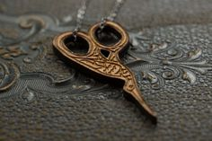 STORK embroidery scissors, wood laser cut necklace £18.00