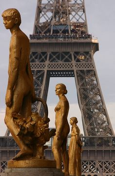 Row of statues with the Eiffel Tower in the background, Paris