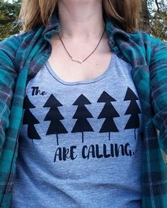 The best thing about our tanks? You can wear them year round with a cozy flannel shirt or sweater. . Last day to shop our tank sale at livelovenorth.com 🌲🌲🌲 . Our favourite way to wear our #thetreesarecalling tank is paired with a @rootscanada plaid shirt and @lacebrickdesign mountain necklace. Doesn't get much better!