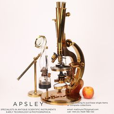 A ROSS-WENHAM UNIVERSAL INCLINING & ROTATING BINOCULAR MICROSCOPE, ENGLISH CIRCA 1888. Signed on the base Ross 5415 this is a fine example of Wenham's Universal Inclining & rotating microscope often referred to as the 'Ross Radial'. Side view with bulls-eye table condenser