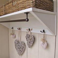 Painted wall shelf with storage baskets, hooks and rail.